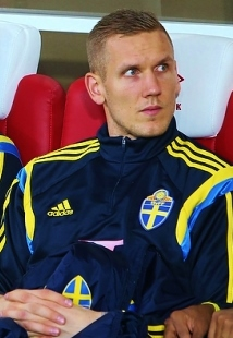Robin Olsen, fonte By Евгений Сойкин - soccer.ru, CC BY-SA 3.0, https://commons.wikimedia.org/w/index.php?curid=42938955